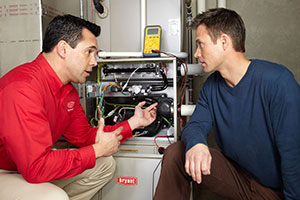 Homeowner Discussing Heating Problems with Service Technician