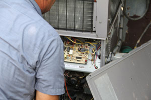 Technician performing HVAC system inspection