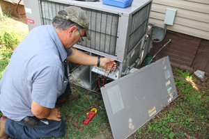 Technician performing AC system inspection