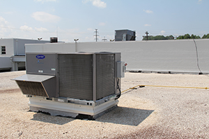 Air conditioning unit on the roof of a commercial building